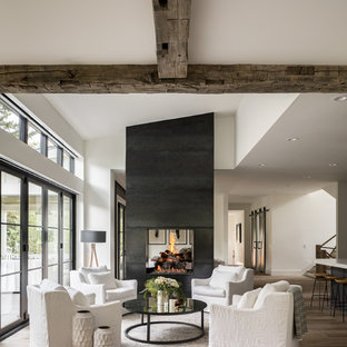 Cottage formal and open concept medium tone wood floor and brown floor living room photo in Denver with white walls, a two-sided fireplace and no tv