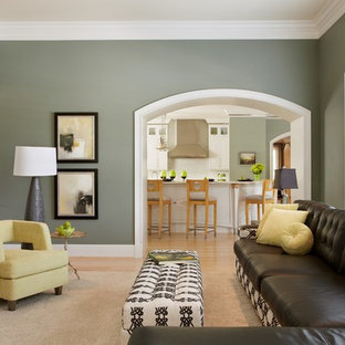 Inspiration for a contemporary enclosed living room in St Louis with green walls, light hardwood flooring and a concealed tv.