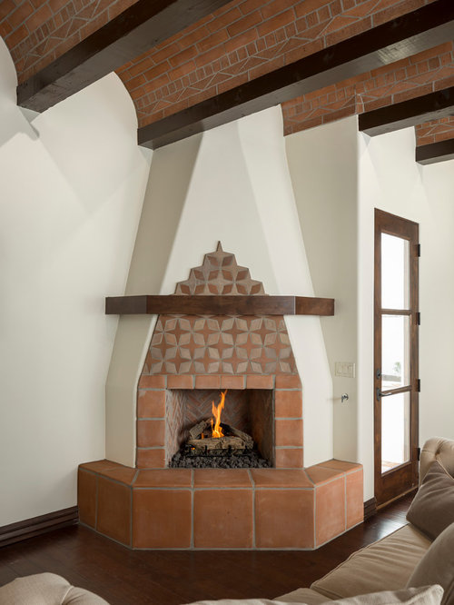 Mediterranean living room design ideas renovations for Mediterranean fireplace designs