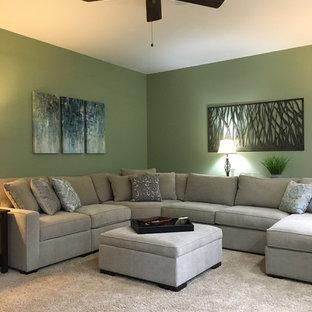 シンシナティの広いトランジショナルスタイルのおしゃれな独立型リビング (フォーマル、緑の壁、カーペット敷き、標準型暖炉、石材の暖炉まわり、テレビなし、ベージュの床) の写真