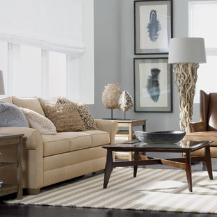 Inspiration for a small beach style formal and open concept dark wood floor and brown floor living room remodel in New York with gray walls, no fireplace and no tv