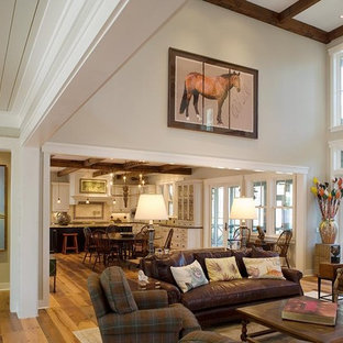 Example of a mountain style open concept living room design in Charleston