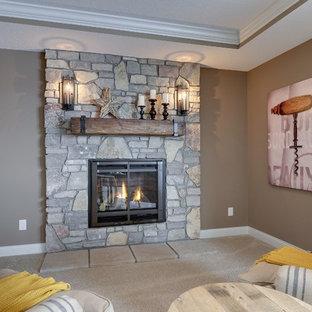ミネアポリスの大きいラスティックスタイルのおしゃれなリビング (茶色い壁、カーペット敷き、標準型暖炉、石材の暖炉まわり) の写真