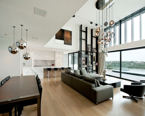 Inspiration for a contemporary open concept living room remodel in Auckland  with white walls