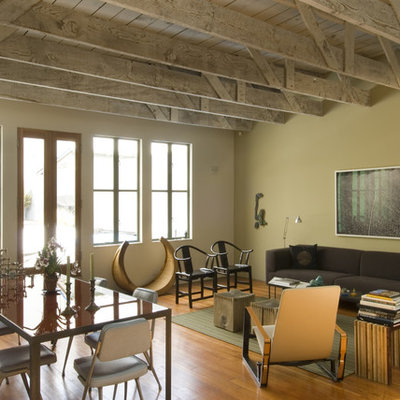 Inspiration for an industrial open concept medium tone wood floor living room remodel in San Francisco
