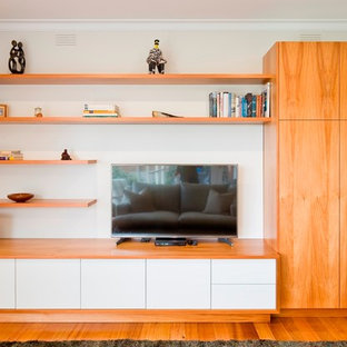 Living room - mid-sized contemporary light wood floor living room idea in Melbourne with white walls and a tv stand