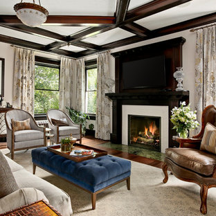 Traditional living room in Denver with a home bar, beige walls, dark hardwood floors, a standard fireplace, a tile fireplace surround and a wall-mounted tv.