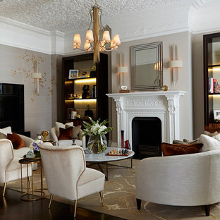 Inspiration for a classic enclosed living room in London with grey walls, dark hardwood flooring and a standard fireplace.