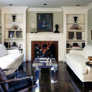 Foto de salón para visitas tradicional renovado, sin televisor, con suelo de madera oscura, chimenea tradicional y marco de chimenea de ladrillo