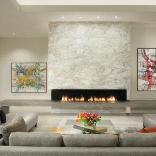 Idee per un soggiorno design aperto e di medie dimensioni con sala formale, pareti bianche, camino lineare Ribbon, pavimento in marmo, cornice del camino in pietra, nessuna TV e pavimento bianco