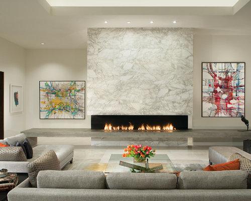Repräsentatives, Offenes, Mittelgroßes, Fernseherloses Modernes Wohnzimmer  Mit Weißer Wandfarbe, Gaskamin, Marmorboden
