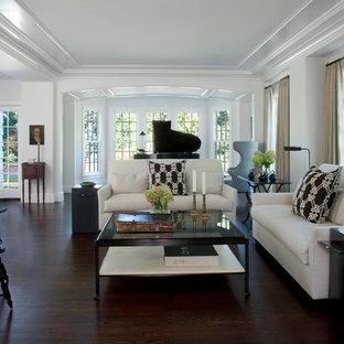 Ejemplo de salón con rincón musical abierto, actual, grande, sin chimenea y televisor, con paredes blancas, suelo de madera oscura y suelo marrón