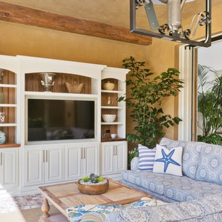 Photo of a medium sized nautical living room in San Diego with brown walls, brick flooring and a wall mounted tv.