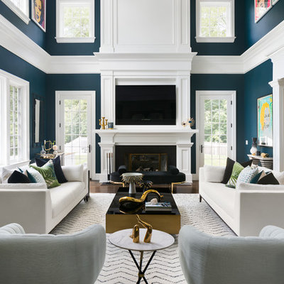 Example of a transitional formal and open concept medium tone wood floor and brown floor living room design in New York with blue walls, a standard fireplace and a wall-mounted tv