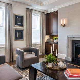 Design ideas for a transitional open concept living room in Boston with grey walls, medium hardwood floors, a standard fireplace, a stone fireplace surround, recessed and wallpaper.