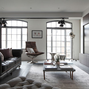 Photo of a medium sized industrial formal open plan living room in London with concrete flooring, a wall mounted tv and white walls.