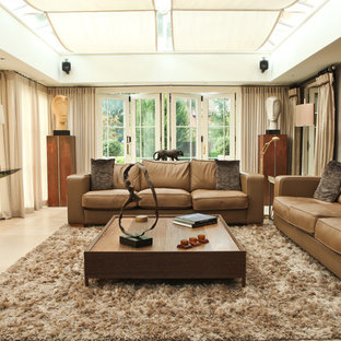 Large traditional living room in West Midlands with brown walls, ceramic floors and no tv.