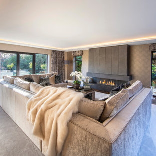 Contemporary living room in Hampshire with brown walls, dark hardwood flooring, a ribbon fireplace and brown floors.