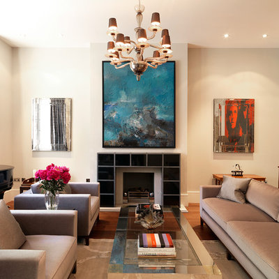Living room - transitional formal medium tone wood floor living room idea in London with beige walls and a standard fireplace