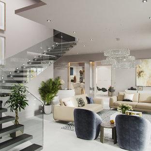 Idee per un soggiorno design di medie dimensioni e aperto con sala formale, pareti bianche, pavimento in compensato, camino classico, cornice del camino in pietra, TV a parete e pavimento bianco