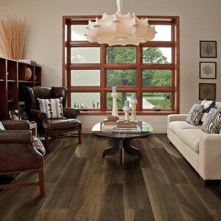 Foto på ett mellanstort funkis separat vardagsrum, med ett finrum, vita väggar, vinylgolv och brunt golv
