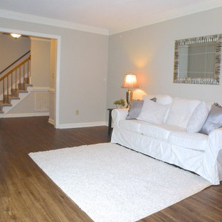 Mid-sized elegant formal and enclosed vinyl floor living room photo in San Diego with gray walls, no fireplace and no tv