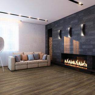 Diseño de salón para visitas abierto, moderno, de tamaño medio, sin televisor, con suelo vinílico, chimenea lineal, marco de chimenea de baldosas y/o azulejos y paredes grises