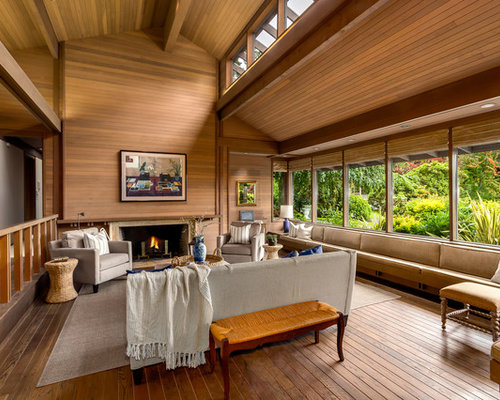 Huge Zen Medium Tone Wood Floor Living Room Idea In Seattle With A Standard  Fireplace And