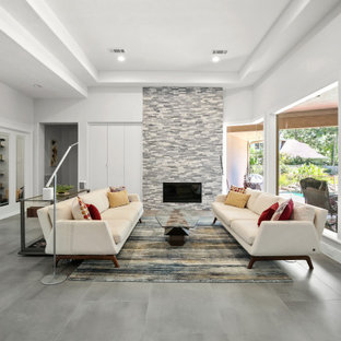 Inspiration for a mid-sized contemporary formal open concept living room in Houston with grey walls, ceramic floors, a standard fireplace, no tv, grey floor and recessed.