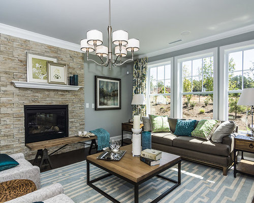 Traditional Living Room Idea In Raleigh With A Stone Fireplace Surround