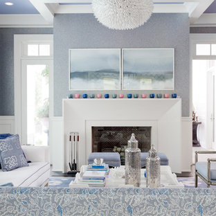 Transitional living room photo in New York with blue walls, a standard fireplace and no tv