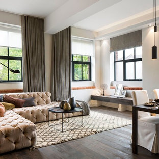 Design ideas for a contemporary open plan living room in London with white walls and dark hardwood flooring.