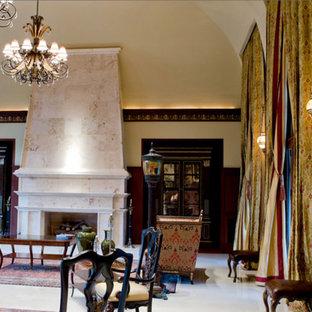 フェニックスの巨大な地中海スタイルのおしゃれなLDK (フォーマル、ベージュの壁、大理石の床、石材の暖炉まわり、テレビなし) の写真