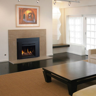 Inspiration for a contemporary living room remodel in Orange County with a standard fireplace