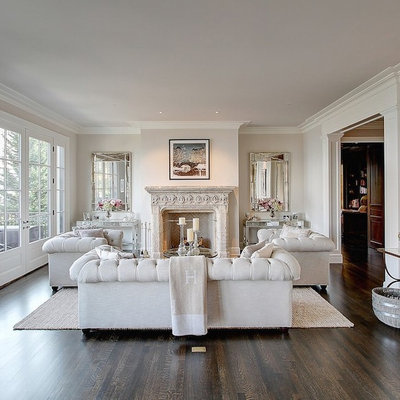 Example of a large transitional enclosed dark wood floor living room design in Seattle with a music area, beige walls, a standard fireplace, a plaster fireplace and no tv