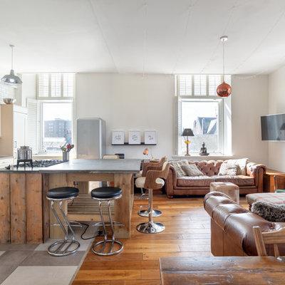 Inspiration for a large industrial ceramic tile living room remodel in Other