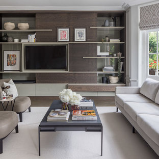 Design ideas for a medium sized contemporary enclosed living room in London with grey walls, dark hardwood flooring, a wall mounted tv and brown floors.