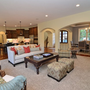 Elegant open concept living room photo in Minneapolis with beige walls