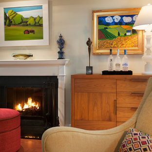 Small trendy open concept medium tone wood floor living room photo in Philadelphia with a bar, beige walls, a standard fireplace, a stone fireplace and a wall-mounted tv