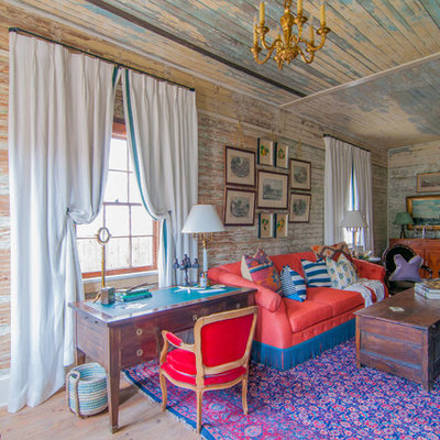 Example of an eclectic formal and enclosed medium tone wood floor living room design in New Orleans with multicolored walls