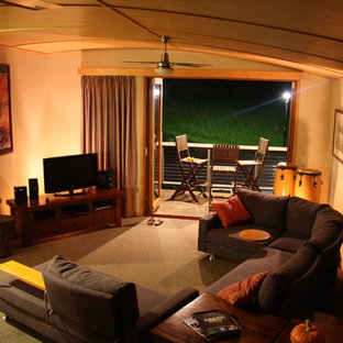 Small tropical open concept living room in Sunshine Coast with carpet.