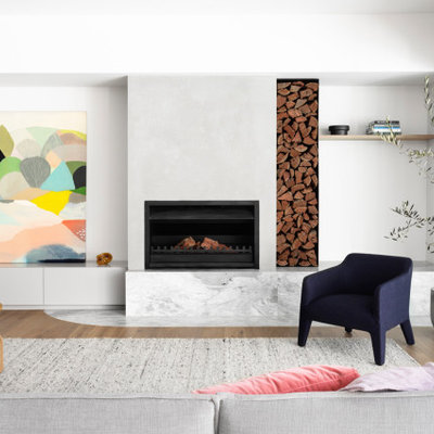 Example of a trendy open concept medium tone wood floor and brown floor living room design in Melbourne with white walls and a standard fireplace