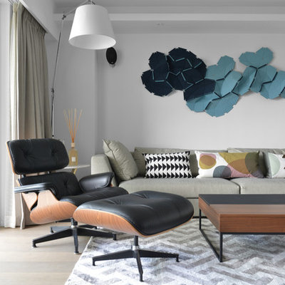 Inspiration for a scandinavian formal and open concept light wood floor living room remodel in Hong Kong with white walls