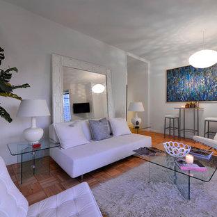 Example of a trendy enclosed medium tone wood floor living room design in New York