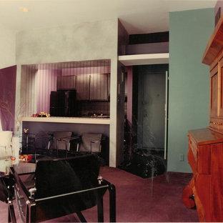 Esempio di un piccolo soggiorno boho chic aperto con pareti verdi e moquette