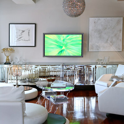 Example of a trendy open concept dark wood floor living room design in New York with gray walls and a wall-mounted tv