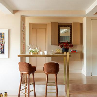 Example of a trendy medium tone wood floor living room design in New York with beige walls