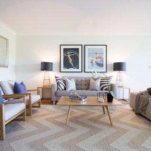 シドニーの中サイズのビーチスタイルのおしゃれなLDK (フォーマル、白い壁、テレビなし、カーペット敷き、マルチカラーの床、暖炉なし) の写真