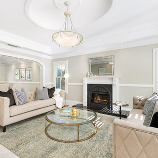 Design ideas for a mid-sized transitional formal enclosed living room in Sydney with grey walls, carpet, a standard fireplace, a plaster fireplace surround, beige floor and coffered.