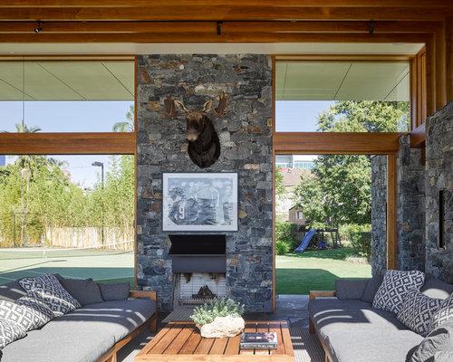 wohnzimmer mit kaminofen und hausbar ideen design